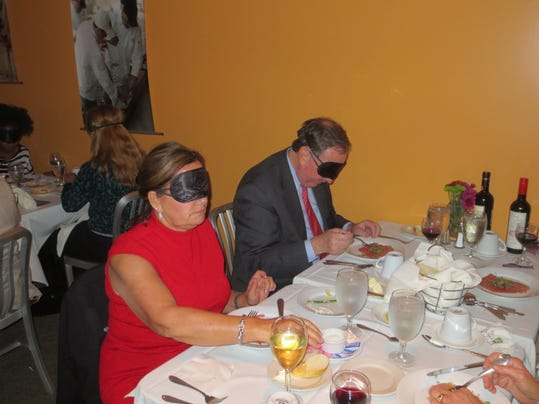 At ForSight Vision s Dining in the Dark event, diners wear blindfolds to heighten their sensory perceptions, such as smell and taste.
