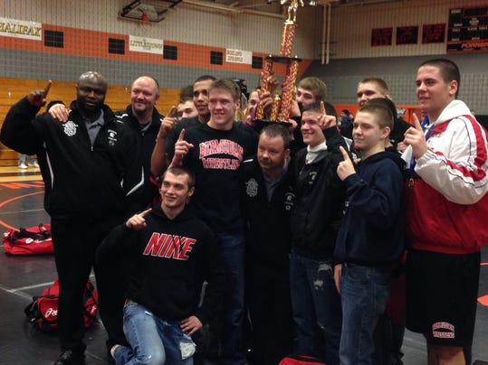 The Bermudian Springs' wrestling team poses after winning the team title at the District 3 Class AA Section 1 tournament on Saturday.