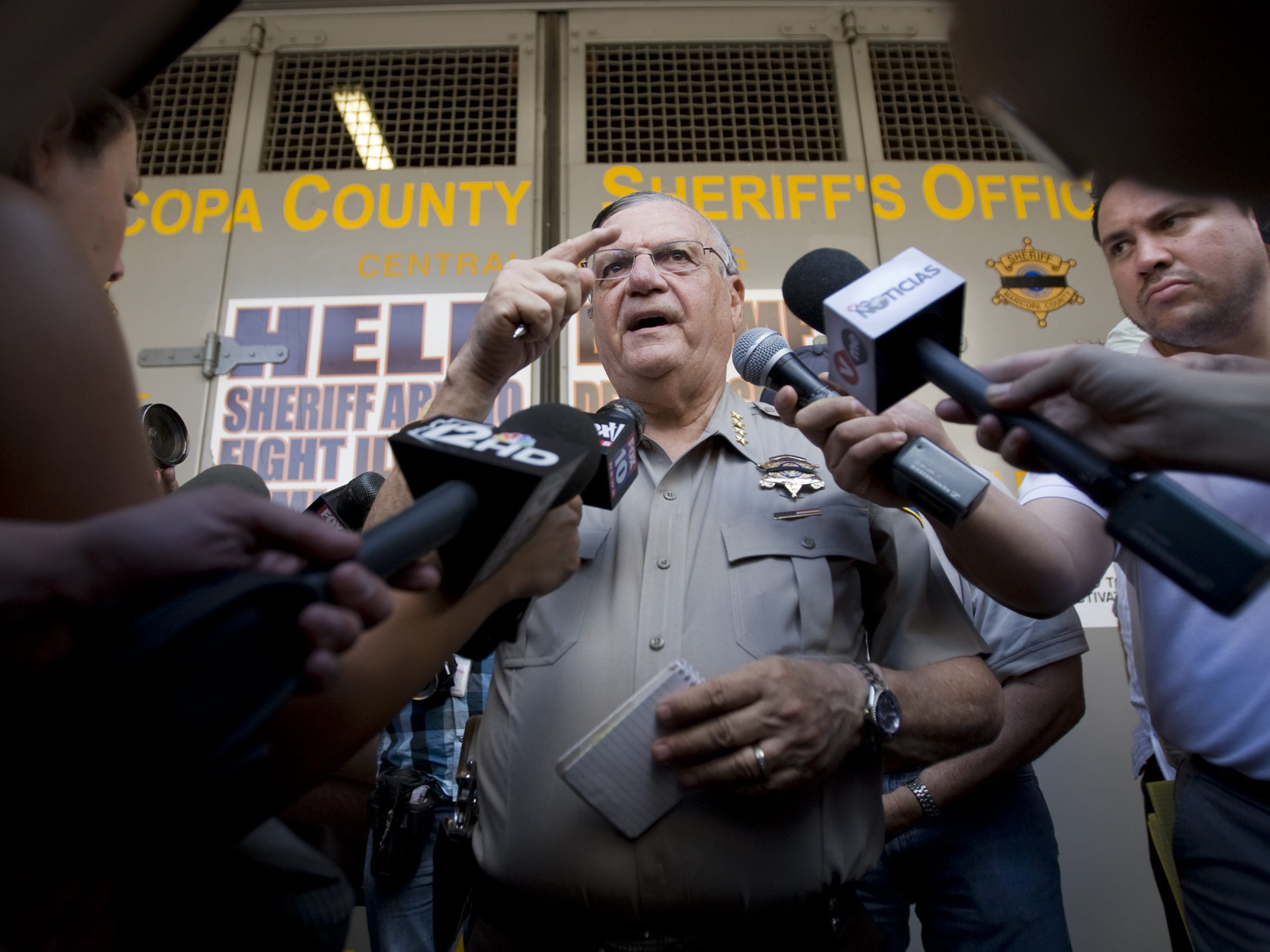 Arpaio speaks to media members in 2010, the year the U.S. Department of Justice yanked the certification that allowed his agency to enforce federal immigration law.