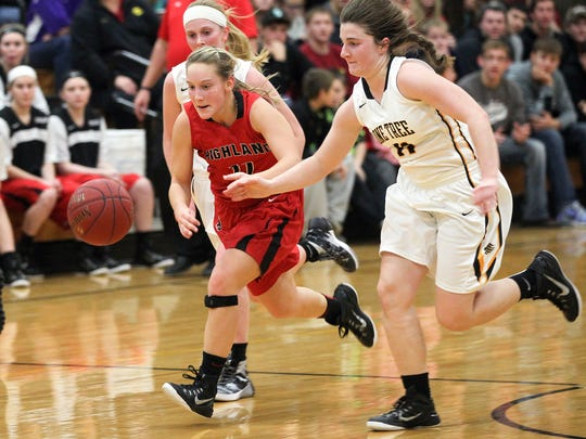 Highland's Cheyann Adamson, left, and Lone Tree's Elena Sieverding chase down a loose ball during their game in Lone Tree on Tuesday, Dec. 15, 2015.