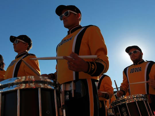 The Hawkeye Marching Band performs for fans outside Kinnick Stadium prior to Iowa's game against Pittsburgh on Saturday, Sept. 19, 2015.