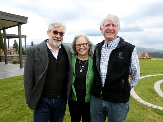 Architect Nathan Good, from left, and co-owners Mary Ann and Mike McNally stand for a photo at Fairsing Vineyard in Yamhill.