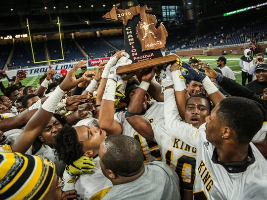 Detroit Martin Luther King players celebrate winning the the division 2 state championship after defeating Walled Lake Western 18-0 on Thursday November 24, 2016, at Ford Field in Detroit, MI.