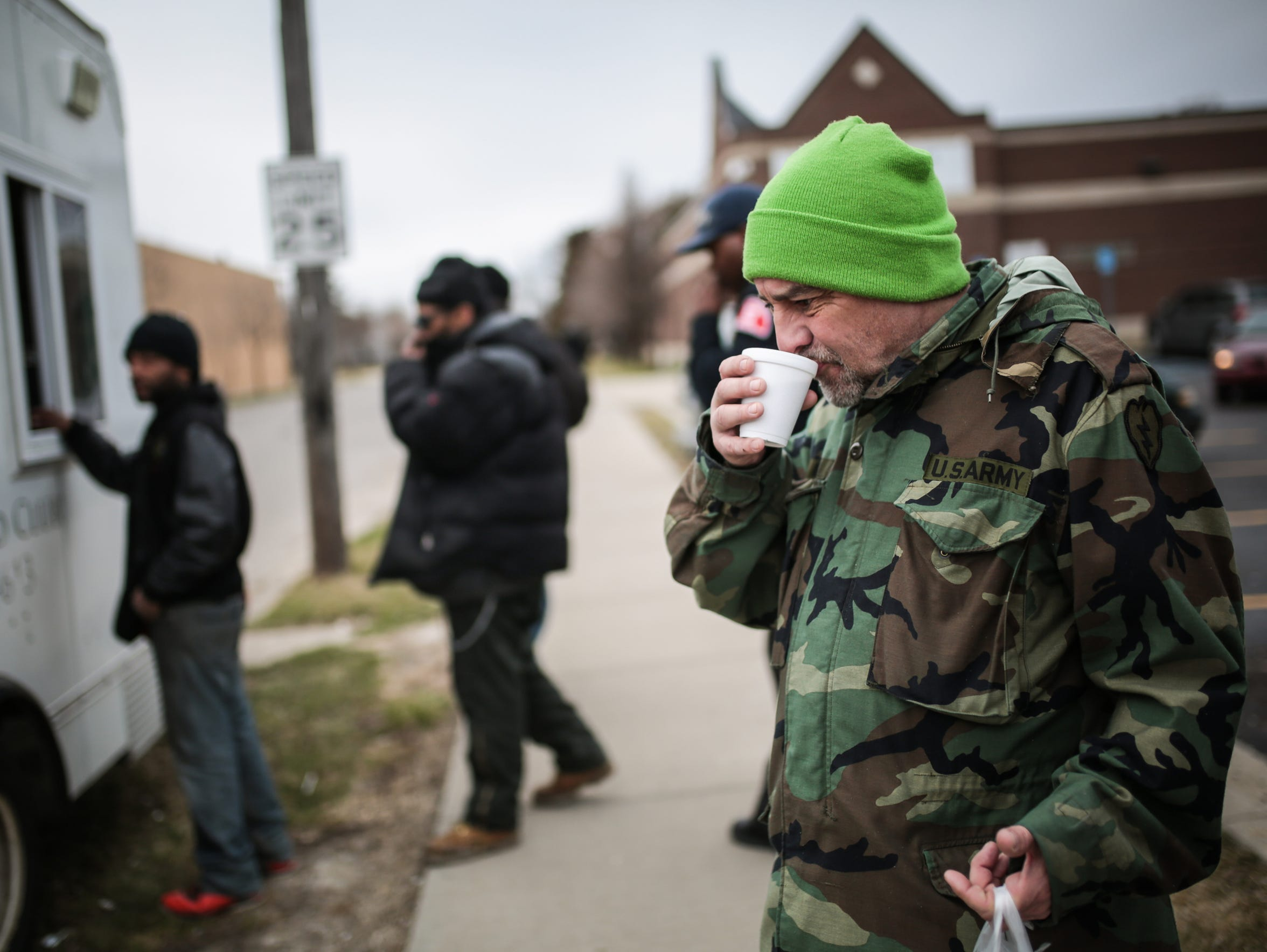 Michael Terrell, 58, of Detroit, drinks hot chocolate