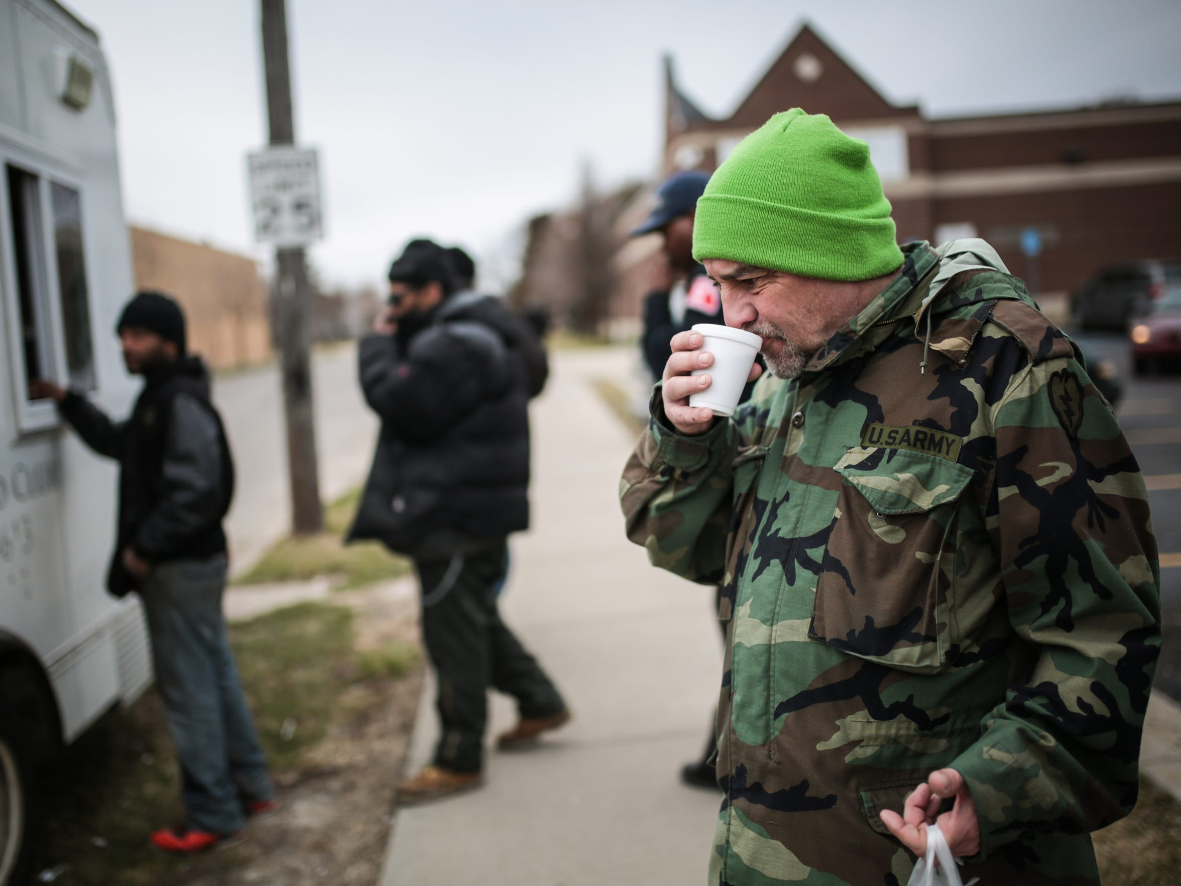 "Michael Terrell, 58, of Detroit, drinks hot chocolate he got from the Salvation Army's Bed and Bread program food truck on March 9, 2017, on Detroit's east side. He served time in jail because he'd had two DUIs and got a third while waiting for his court date on the second. ""People said 'Mike, you gotta stop drinking.' I said no. I just sold my car instead."""