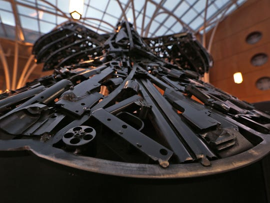 """Some of the recycled gun pieces used to make """"Peace"""