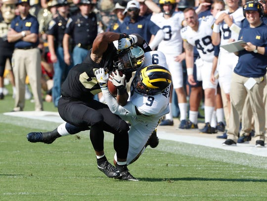 Purdue running back Brian Lankford-Johnson is tackled by Michigan linebacker Mike McCray on Sept. 23, 2017 at Ross-Ade Stadium in West Lafayette, Ind.