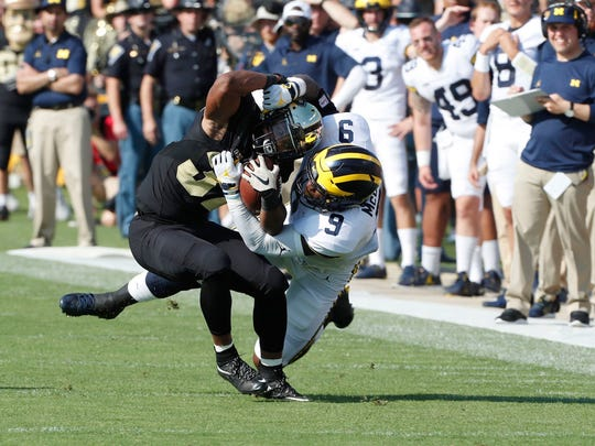 Sept. 23: Purdue running back Brian Lankford-Johnson is tackled by Michigan linebacker Mike McCray. After giving up 10 first-half points, the Wolverines pitched a shutout in the second half.