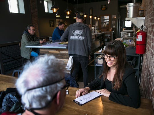 Lily Smith of Indianapolis enjoys a visit to Cannonball Brewing Co., part of a vanguard of new businesses in the Kennedy-King neighborhood.