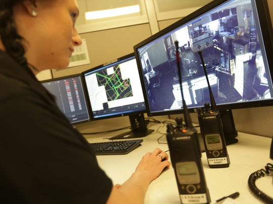 Crime analyst Breanna Lingo monitors video screens