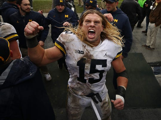 EAST LANSING, MI - OCTOBER 20:  Chase Winovich #15 of the Michigan Wolverines leaves the field after a 21-7 win over the Michigan State Spartans at Spartan Stadium on October 20, 2018 in East Lansing, Michigan. (Photo by Gregory Shamus/Getty Images)