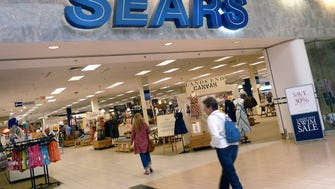 FILE - In this Thursday, May 17, 2012, file photo, shoppers walk into Sears in Peabody, Mass. Sears' announced Thursday, May 26, 2016, its fiscal first-quarter loss widened as it suffered another sales drop at its Kmart and namesake stores. The retailer also announced that it's looking at options for its prized Kenmore, Craftsman and DieHard and Sears Home Services businesses, including possible partnerships or deals that could expand distribution of its brands and service offerings. (AP Photo/Elise Amendola, File) ORG XMIT: NYBZ487