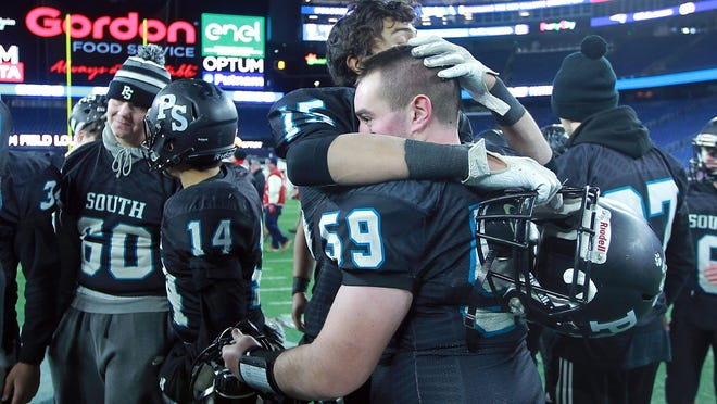 Plymouth South's Chase Sacco and Anthony Loranger embrace following their 28-13 loss to Melrose in the Division 4 state championship game at Gillette Stadium last season.