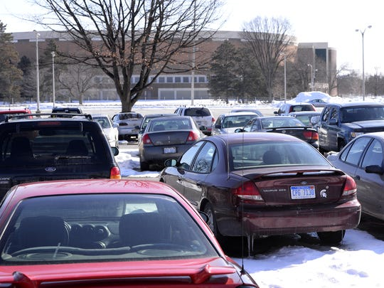 Cars in the current parking lot on the possible site