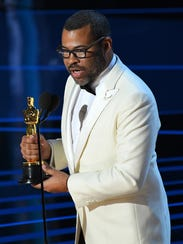 Jordan Peele accepts the Oscar for original screenplay.