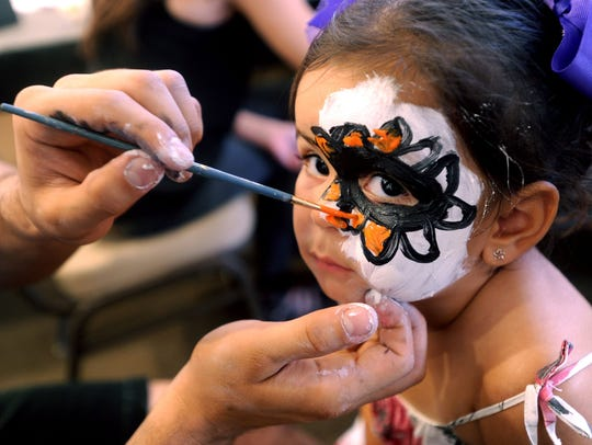 Nesta Faulkner of Ventura has her face painted during a past Dia de los Muertos celebration at the Museum of Ventura County.