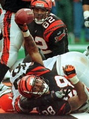 Cincinnati Bengals running back Corey Dillon (28) holds up the ball after scoring on a two-yard run in 1999.