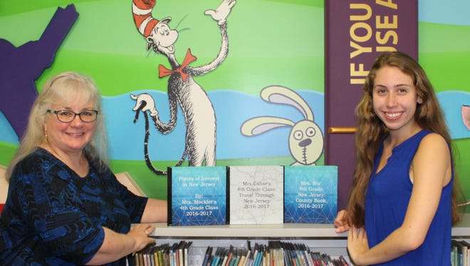Ambassador Girl Scout, Gianna Bossone, donates a set of creative writing books from the newly published authors of BF Gibbs Elementary School 4th Grade Class of 2017 to Terri McColl, Director of the New Milford Public Library.