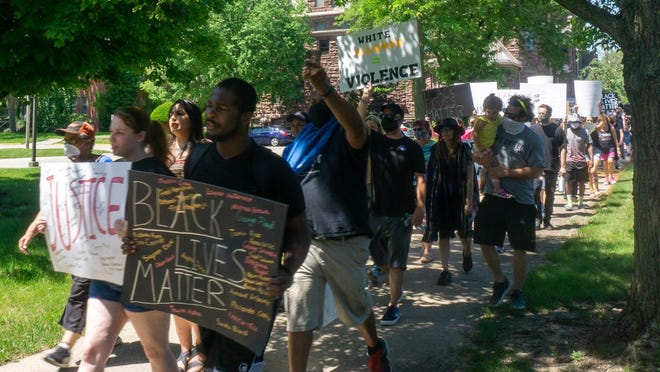 On Saturday afternoon, Black Lives Matter supporters gather and march in downtown Galesburg to circle the Public Safety Building.