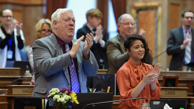 The Legislature gives a standing ovation to the singers on Wednesday, Jan. 25, 2017, as Findley Elementary students sing at the Iowa State Capitol as part of Art Advocacy Day.