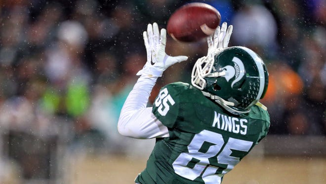Michigan State Spartans wide receiver Macgarrett Kings Jr. (85) attempts to make a fair catch the 2nd half of a game at Spartan Stadium.