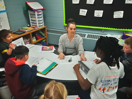 Third-grade students do reading rotation at Kirkwood