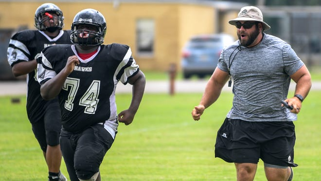 South Side football players practice in full pads Monday for the first time in the 2018 season.