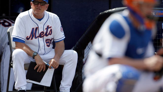 In this March 23, 2013 file photo, Mets pitching coach Dan Warthen watches during an exhibition game against the Washington Nationals, in Port St. Lucie, Fla.