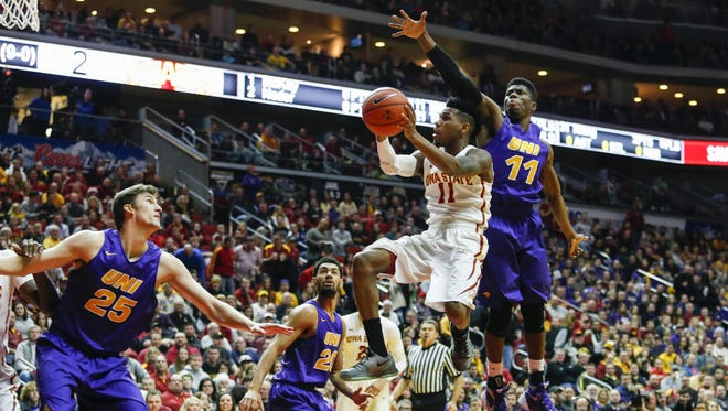 Iowa State junior Monte Morris cuts under the reach of Northern Iowa's Wes Washpun en route to the basket on Saturday.