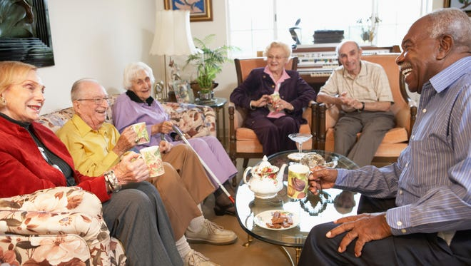Senior adults having morning tea together.