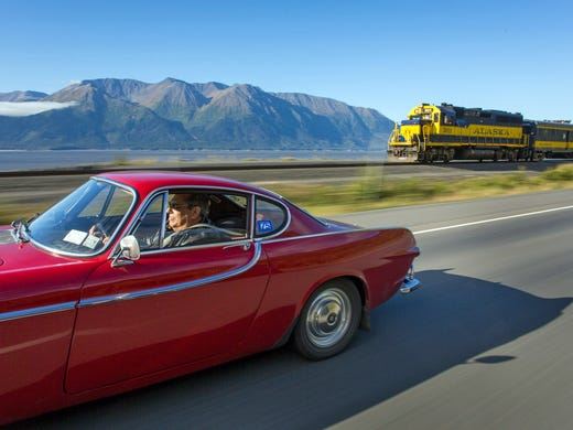 Irv Gordon drives along Alaska Hwy. 1 as he approaches 3 million miles in his 1966 Volvo P1800.