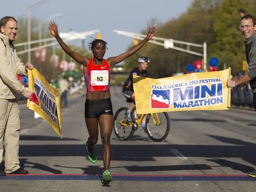 Lilian Mariita, the women's winner of the 500 Festival Mini Marathon, Indianapolis, Saturday, May 3, 2014.