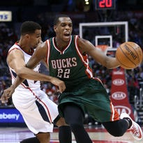 Milwaukee guard Khris Middleton (22) reacts as he looses the ball after he drove against Atlanta forward Thabo Sefolosha (25) in the second quarter.