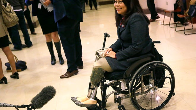 Rep.-elect Tammy Duckworth, D-Ill., stops to speak with the media prior to a meeting with new members-elect, on Capitol Hill in Washington, Wednesday, Nov. 14, 2012. (AP Photo/Pablo Martinez Monsivais) ORG XMIT: DCPM103