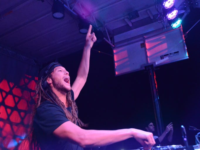 DJ Henry Fong screams to the audience at UCF ATO's