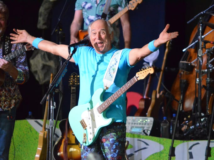 Jimmy Buffett greets the sold-out crowd at DTE Energy