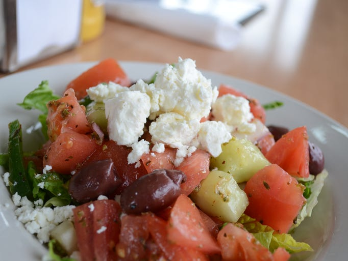 The Greek Village Salad includes tomatoes, kalamata