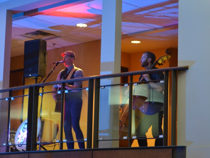 The Belle Weather acoustic band performed on the balcony