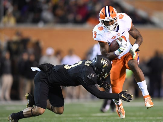 Wake Forest safety Jessie Bates (3) tries to bring down Clemson running back Wayne Gallman (9) during the 1st quarter at Wake Forest's BB&T field on Saturday, November 19, 2016.