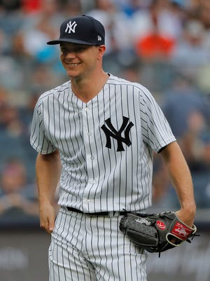 New York Yankees starting pitcher Sonny Gray, left, smirks as he leaves the game to a chorus of boos during the third inning of a baseball game against the Baltimore Orioles, Wednesday, Aug. 1, 2018, in New York. The Orioles won 7-5. (AP Photo/Julie Jacobson)