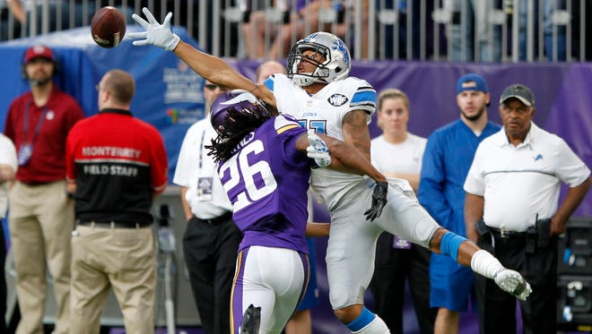 Minnesota Vikings cornerback Trae Waynes (26) breaks up a pass intended for Detroit Lions wide receiver Marvin Jones, right, during the second half of an NFL football game Sunday, Nov. 6, 2016, in Minneapolis. The Lions won 22-16 in overtime. (AP Photo/Andy Clayton-King)