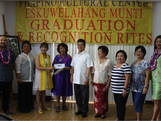 The Filipino Community of Guam headed by its President, Nita Baldovino (third from left) donated $1,000 to Eskuwelahang Munting Guam principal Mila Moguel. Two FCG officers, Norman Analista, FCG 1st vice president and Kaye Custodio, public relations officer, graduated from the program. The donation was witnessed by Consul General Marciano R. de Borja (middle) and other FCG officers. Left to right: Analista, Gloria Baguinon, FCG peace officer, Baldovino, Moguel, de Borja, Ciony Viray, volunteer teacher, Edna Rebanal, FCG secretary, Lynda Caasi, FCG treasurer and Custodio.