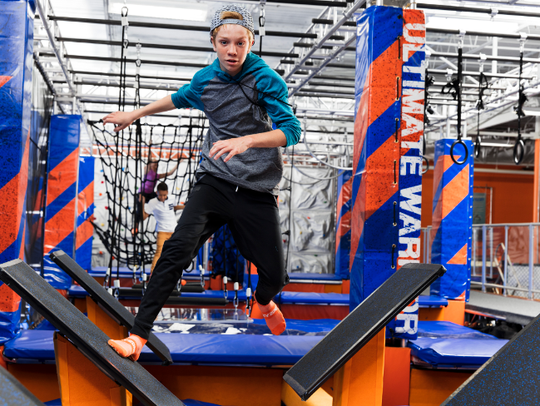 A determined warrior goes through a Ninja Warrior Course