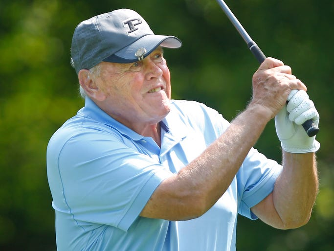Former Purdue coach Gene Keady watches his drive on No. 7 during Coach  Keady's Legacy golf tournament Friday, August 1, 2014, at Coyote Crossing in West Lafayette.