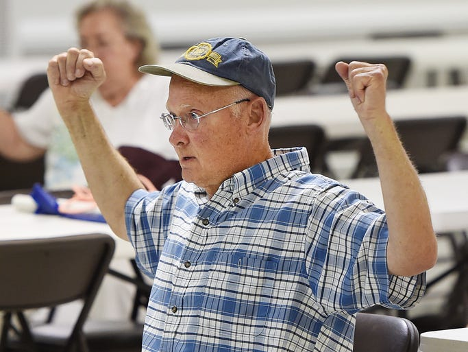 Christopher Sampson from Dagsboro does exercises as Sonny Meyer leads a group Parkinsons patients and family members in exercises at the Elks Lodge near Lewes.