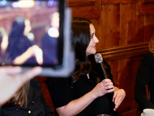 "Melissa Porch, founder of Believe, Give, Network, speaks on Thursday at Outback Steakhouse in Farmington during one of the organization's ""Little Black Dress"" events."