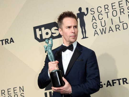 Sam Rockwell poses with his SAG Award for his supporting