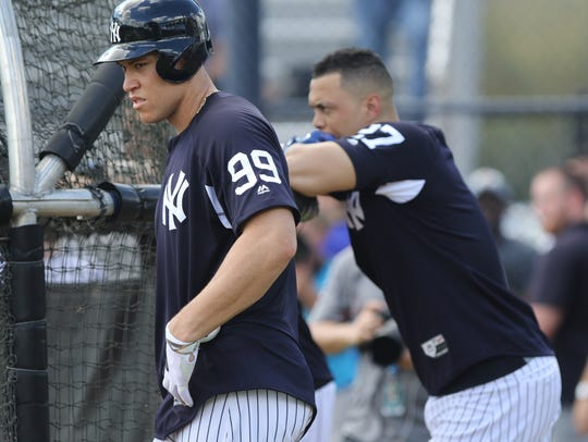 Aaron Judge and Giancarlo Stanton wait to hit in the