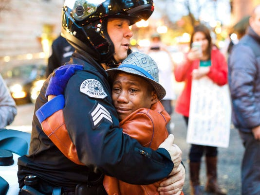 AP APTOPIX FERGUSON PROTEST EMBRACE A USA OR