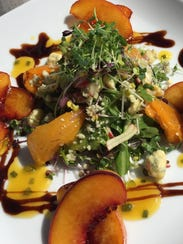 A salad of Florida Microgreens, peaches and Stilton